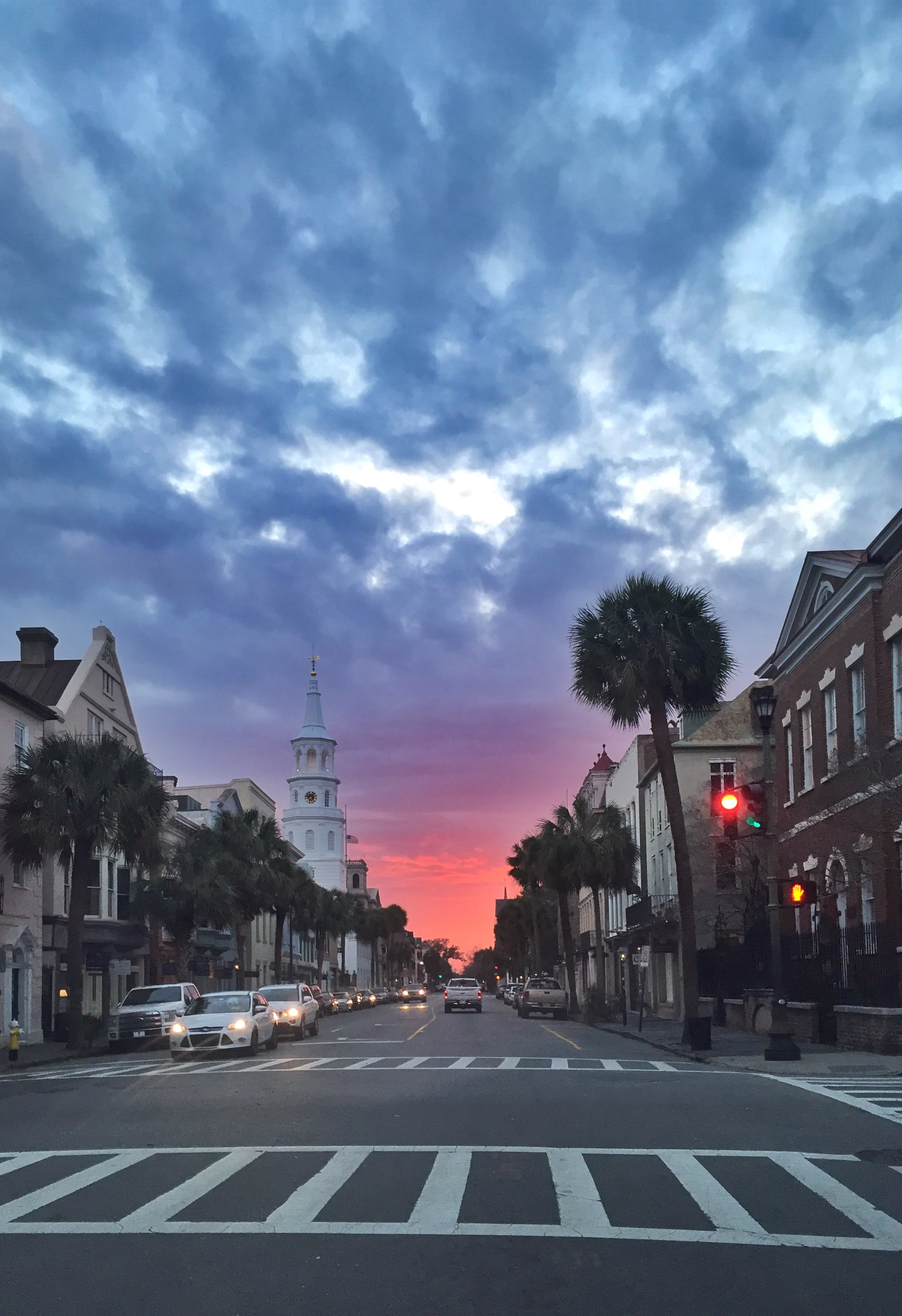 """HONORABLE MENTION Amateur category: Sunset on Broad by Joanna Walker; """"This image was taken as the sun was setting over Broad Street on March 13 at about 7:25. I was driving and just in awe of what was in front of me. Luckily I got stopped at this red light so I had the chance to snap this picture."""""""