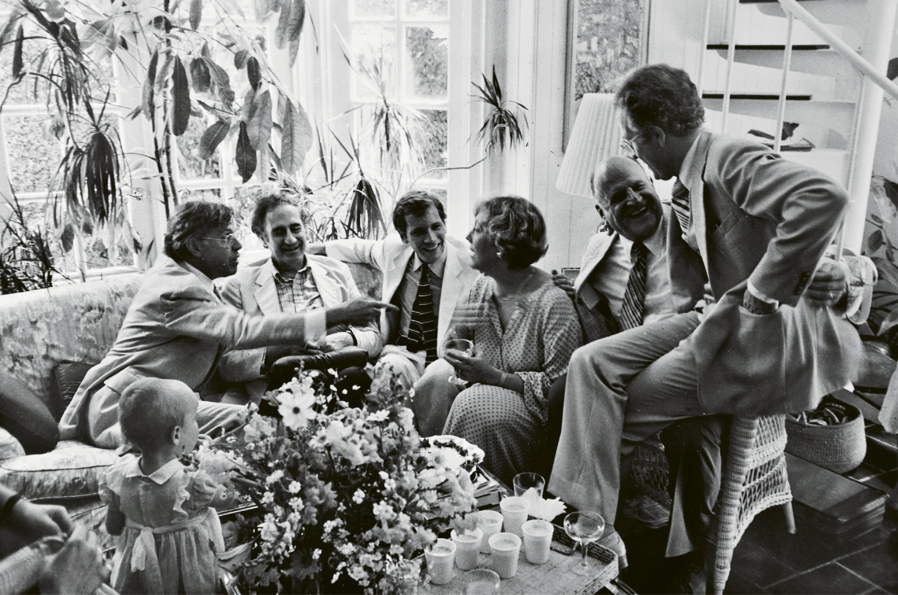 GARDEN PARTY: Ever the hostess, Patti entertains (from left) Charles Wadsworth, Gian Carlo Menotti, Jim Kearney, Ted Stern, and Scott Nickrenz in the McGee family sunroom overlooking the garden, after a Spoleto Festival USA chamber music concert in 1979.