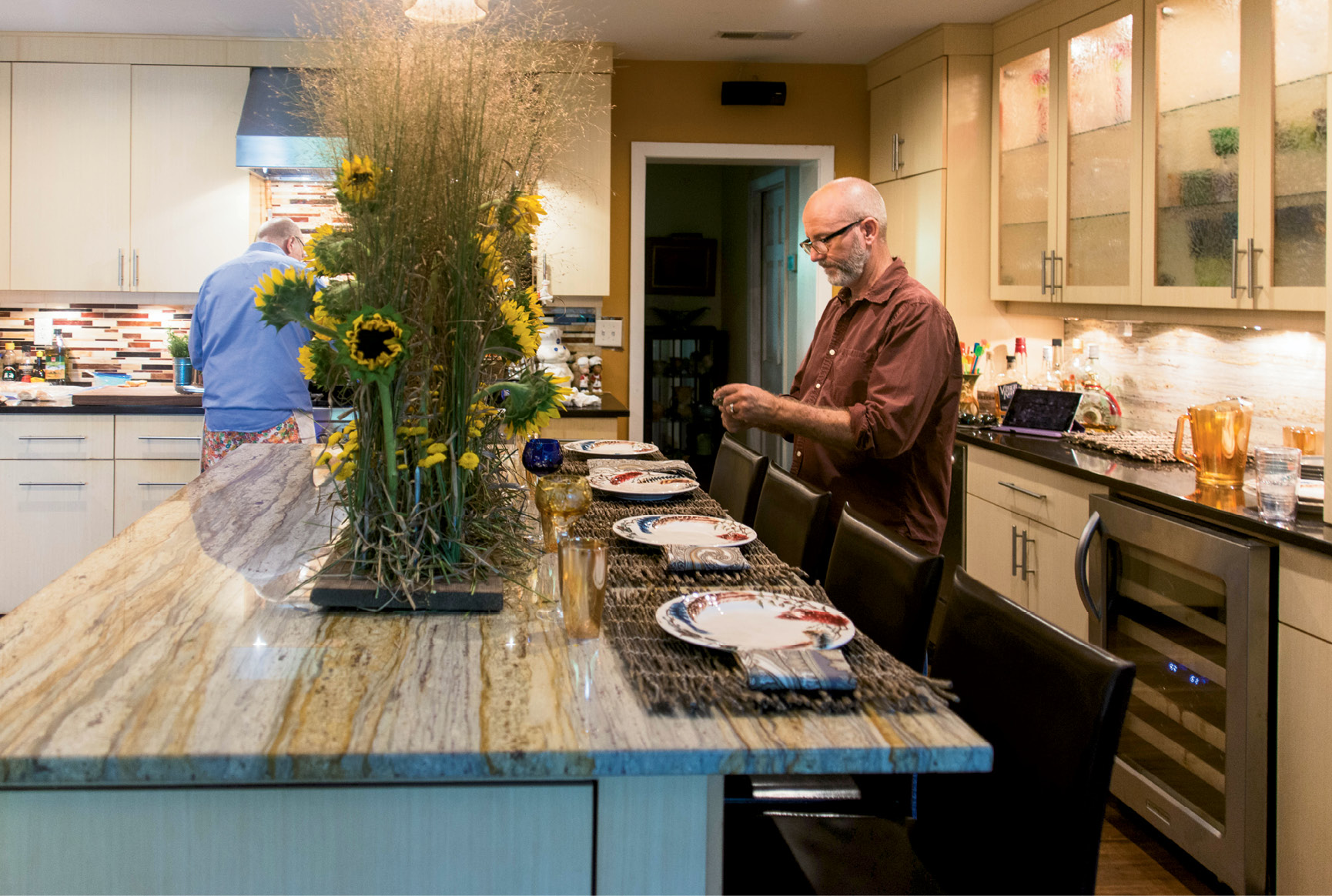 David Vagasky (left) preps the meal while Jim Martin sets the dining space.
