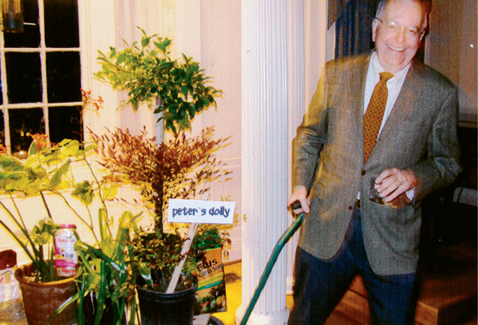 TEAM EFFORT: Peter with a dolly full of plants—always there to cheer and support his wife's passion for gardening