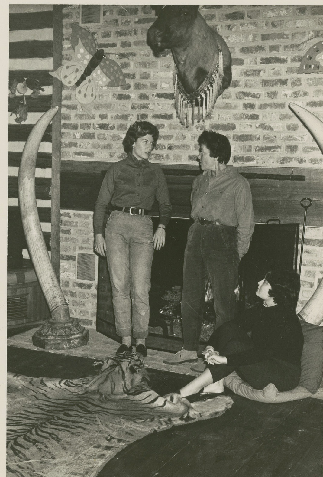 "With daughters Landine and Bokara (seated) in Medway's ""Trophy Room,"" undated"