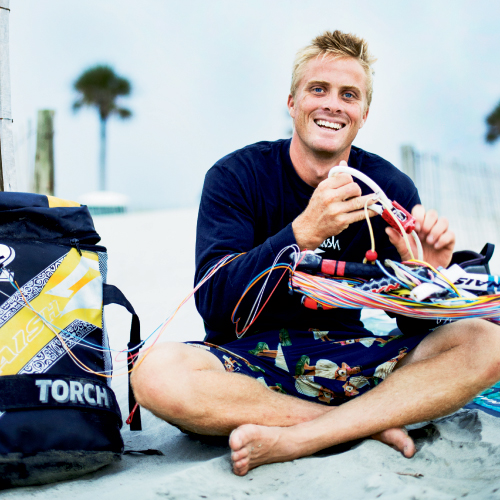 """Charleston native Davey Blair has travelled the globe for more than a decade seeking wind, waves, and thrills. Shown riding a light breeze back home on the harbor, the ever-positive pro says, """"No matter what, it's always fun just being on the water."""""""