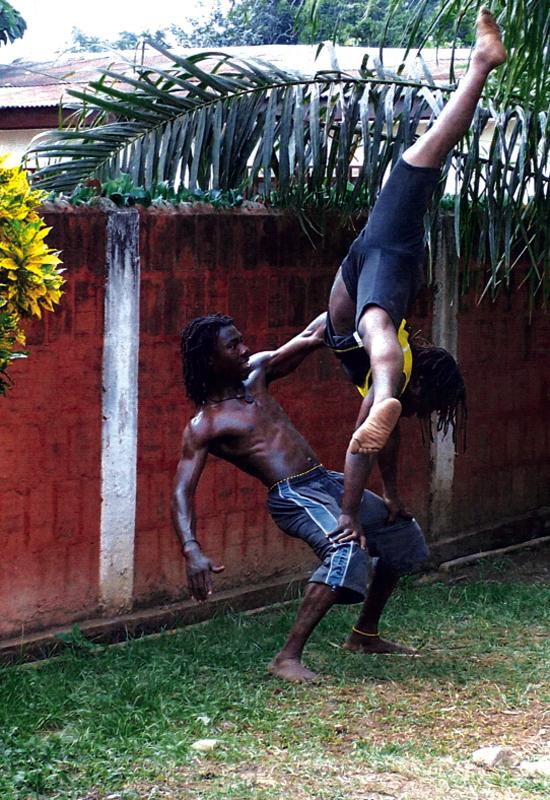 Two members of Nkabom defy gravity.