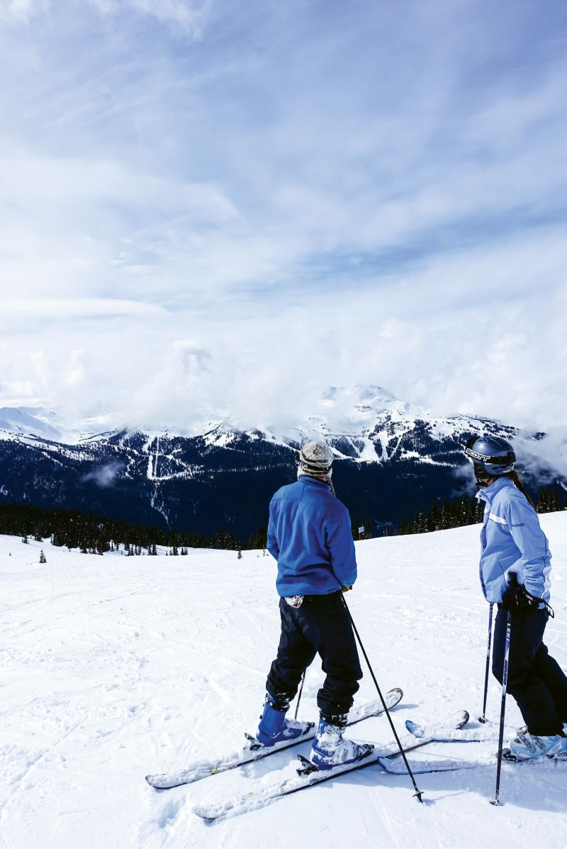 Two Mountains, One Resort: Charleston-born Hank Rudolph V and a friend stand atop a run on Blackcomb Peak and take in the view of Whistler Mountain across the valley, accessible by an awe-inspiring gondola ride.