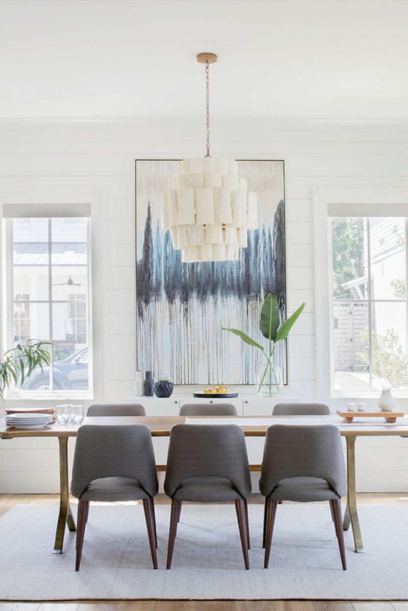 Sit a Spell: Most mornings—post-school-drop-off—find Tracie in the light-filled dining room reviewing images and reading magazines. The oak table is from Anthropologie, and the resin-covered banana-bark chandelier from Candelabra.