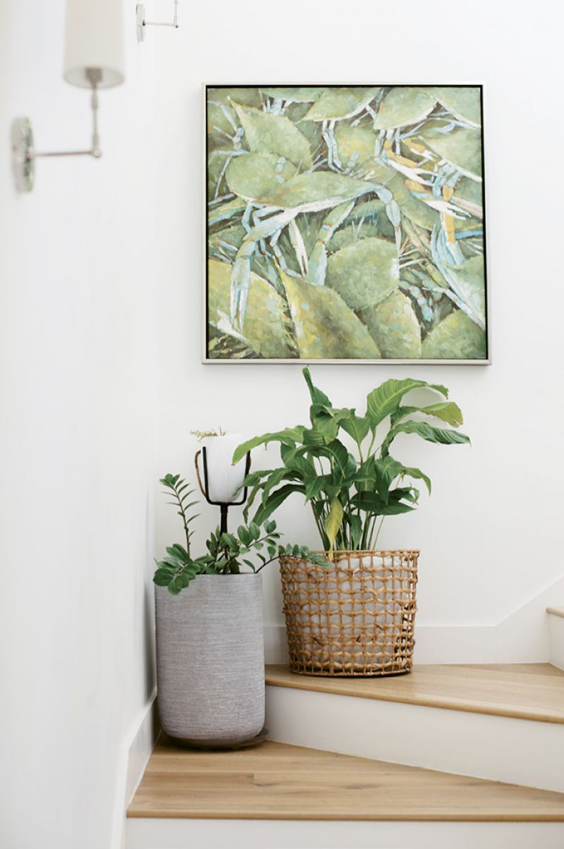 """Coastal Living: Hanging in the stairwell to the boys' rooms, the painting of blue crabs came from their home in Augusta: """"I guess we were always aiming for the coast,"""" Tracie says."""