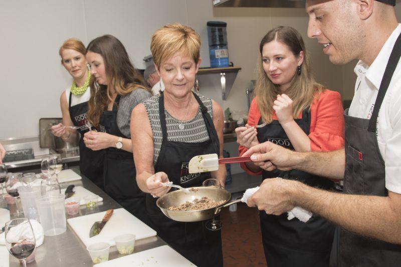 Gerri Greenwood tries the pork for the Asian pork lettuce wraps.