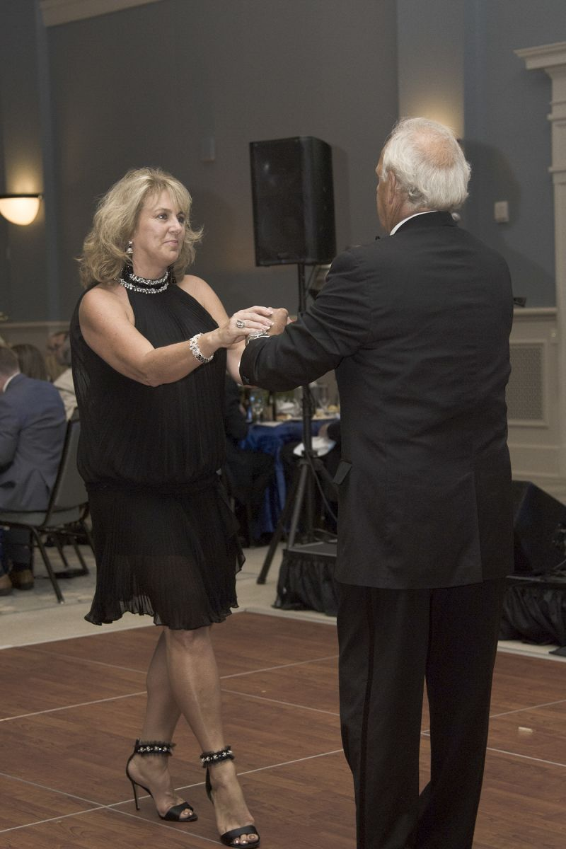 Once in the dining room, many guests danced both before and after the dinner and live auction.