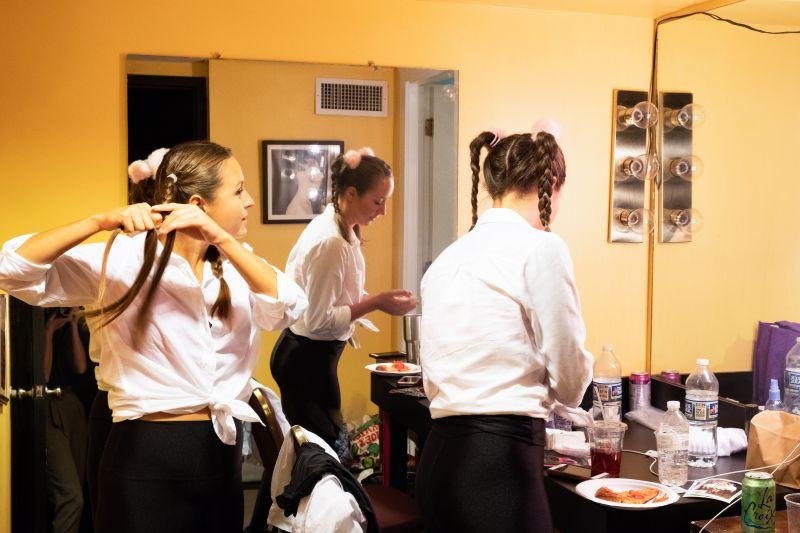 Kimi Hrivnak and Dani Mushinsky get ready for their appearance in Lauren Fox's Britney Spears number,