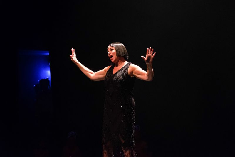 """Susan Pearlstine kicks off her performance of """"All That Jazz."""""""