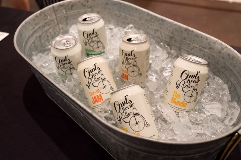 Fitting the theme of the exhibit, Owl's Brew Radler was the evening's drink of choice.