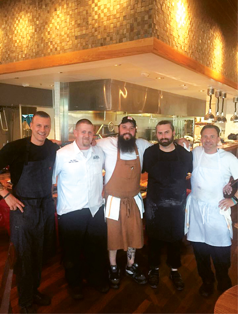Ben (pictured far right) on opening night with chefs Scott Crawford, Eric Zizka, Bobby Hodge, and Elliot Cusher