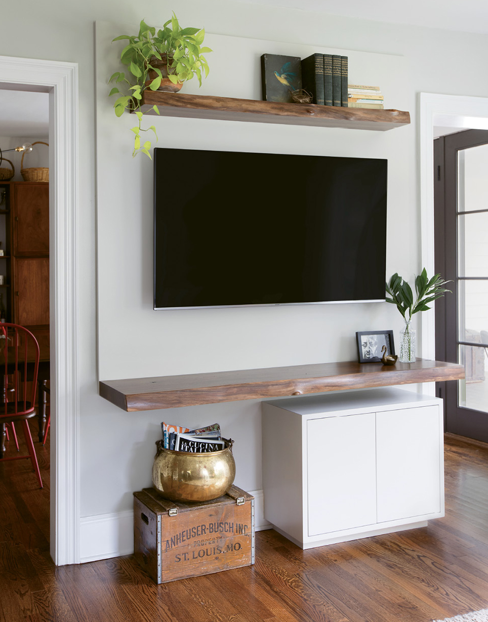 Crafted by local carpenter and friend Dan Perrin of Perrin Woodworking, this custom media console echoes the look and feel of a mantel.