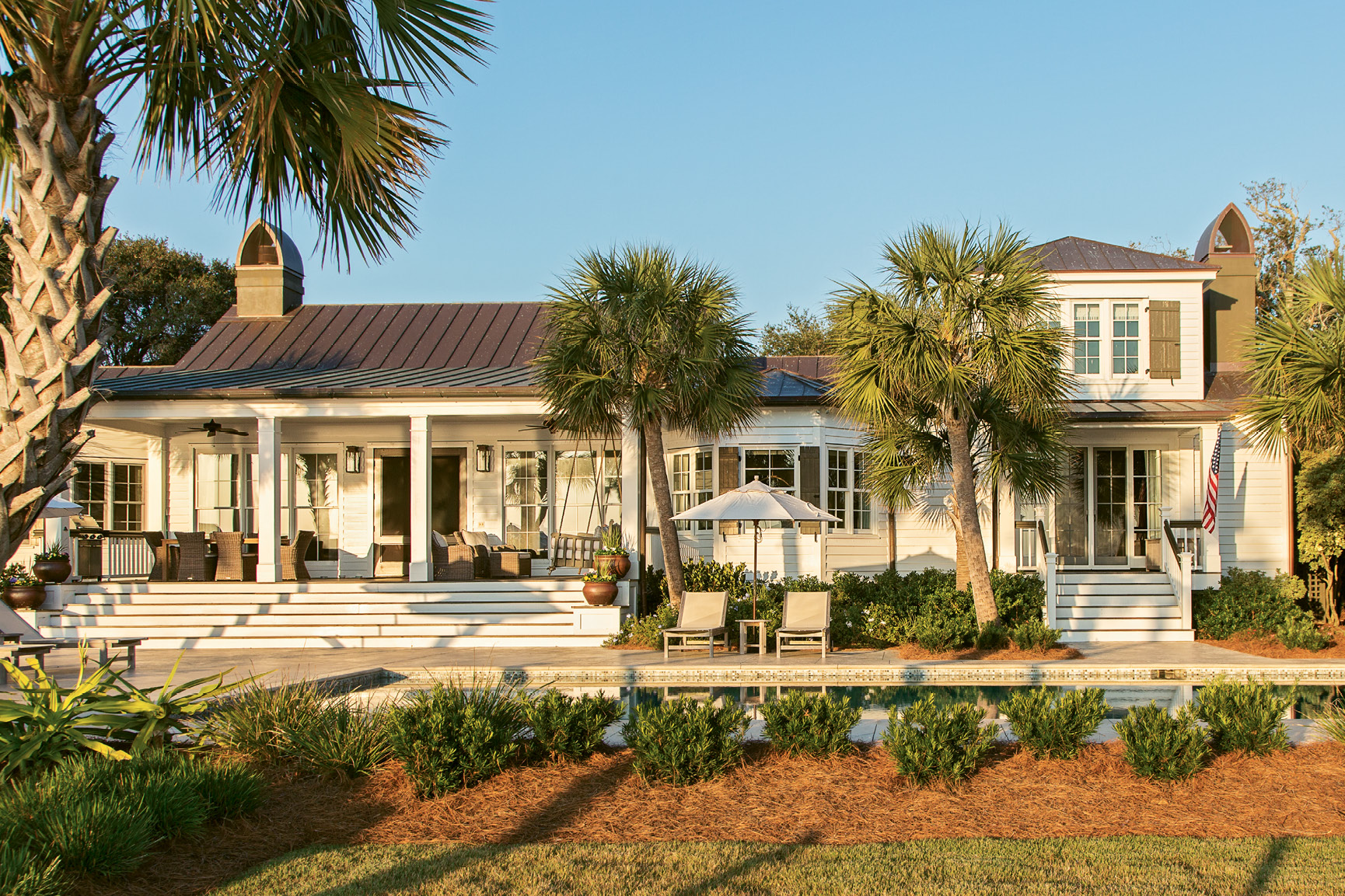 LOVE AT FIRST SIGHT: Charleston native Tara King first fell for this Sullivan's Island house in her teens. After admiring it from afar for some 25 years, she and her husband, Kirk, purchased the more-than-a-century-old home in 2011. In the process of making it their own, they added a new back porch with French doors to maximize oceanfront views.