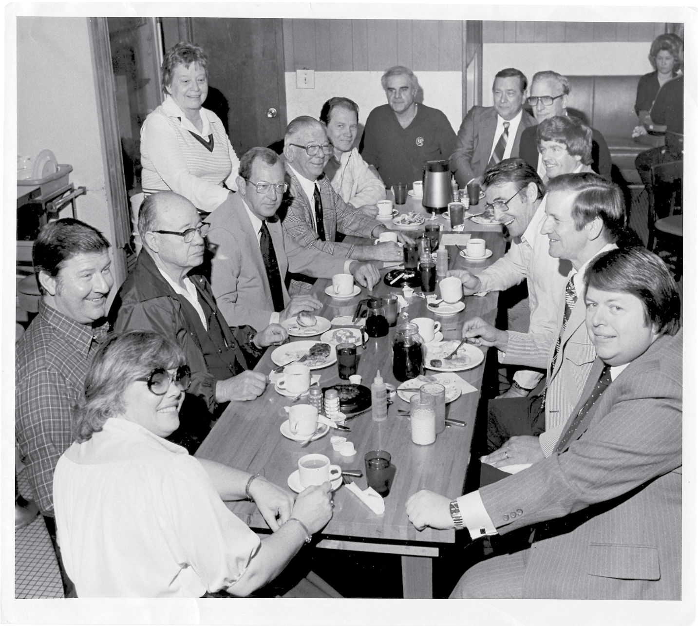 "Kitty's ""Coffee Club"" circa 1980, its members gathered every morning at 9:15, Miss Kitty is standing on the left."