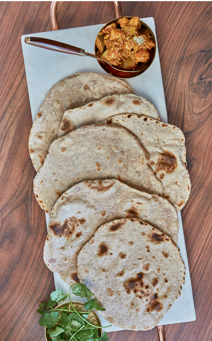 Chapati, a traditional Indian flat bread, is used to scoop up curry dishes at the dinner table.