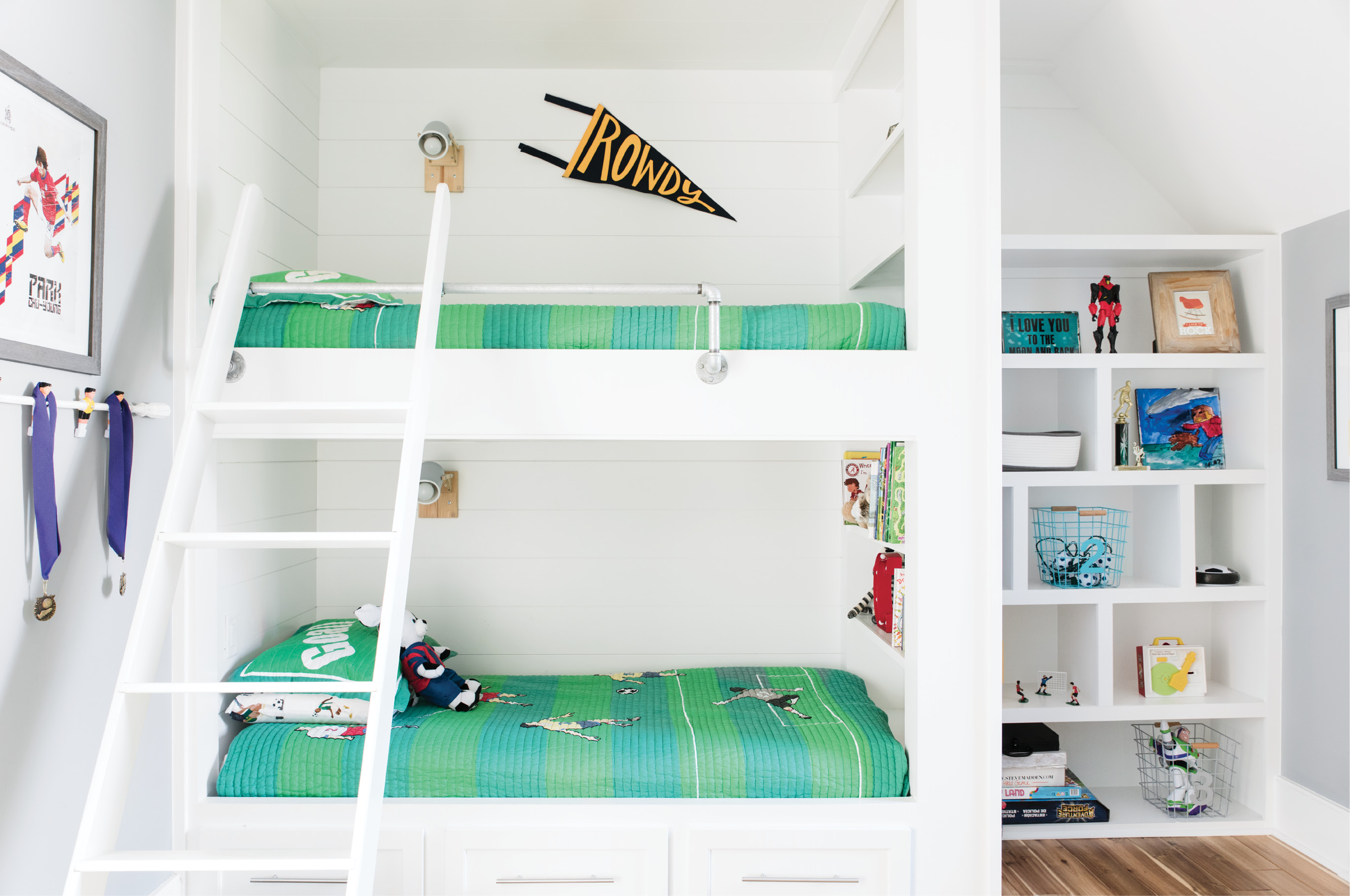 Bunk House: In eight-year-old Cruz's room, soccer-themed bedding from Wayfairer.com adds a kid-friendly dose of color to shiplap bunk beds. A few lengths of pipe and fittings make for a stylish rail on the top bunk.