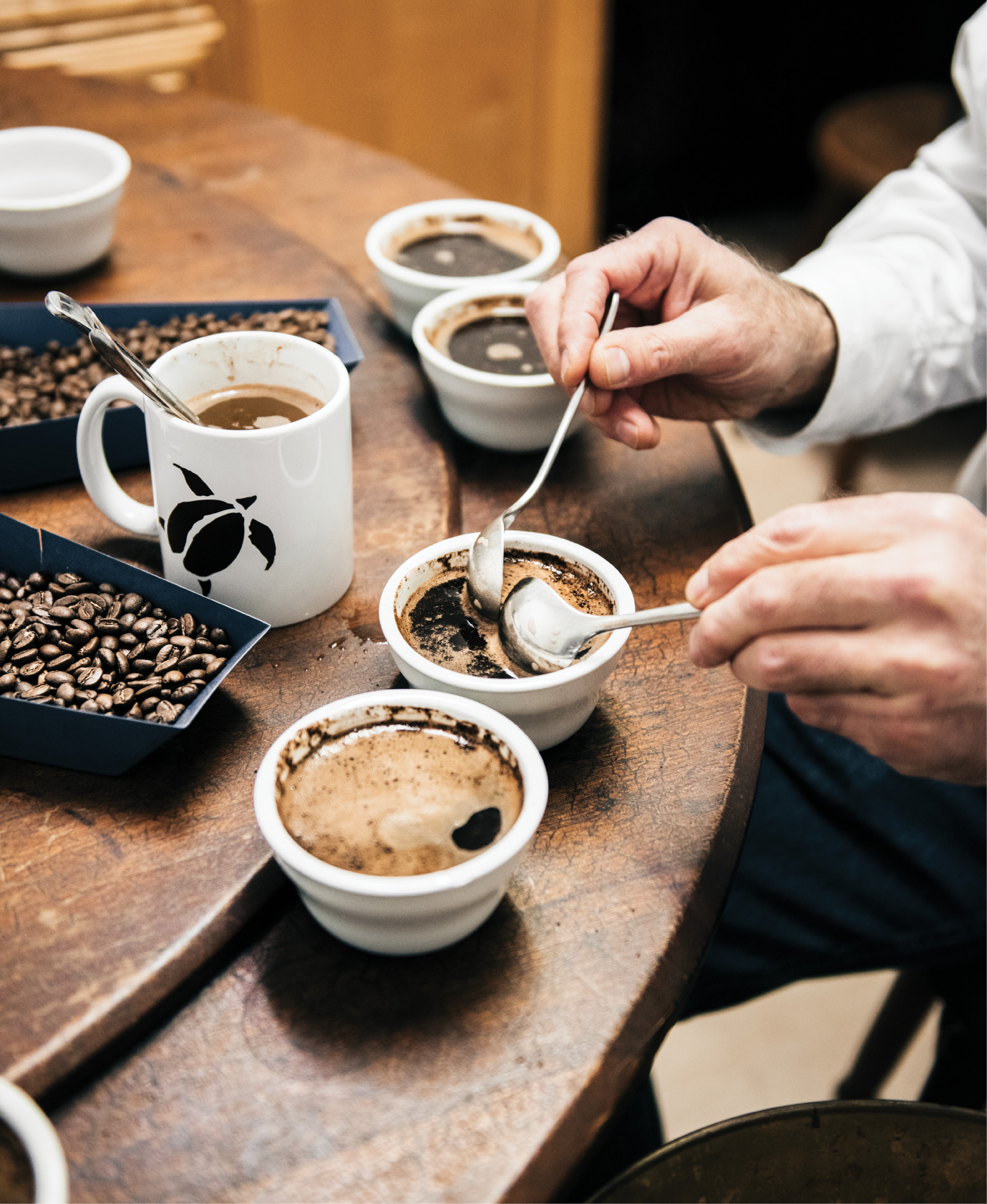Higher Grounds: Charleston Coffee Roasters's Lowell Grosse demonstrates the art of cupping using deep spoons made expressly for the practice.