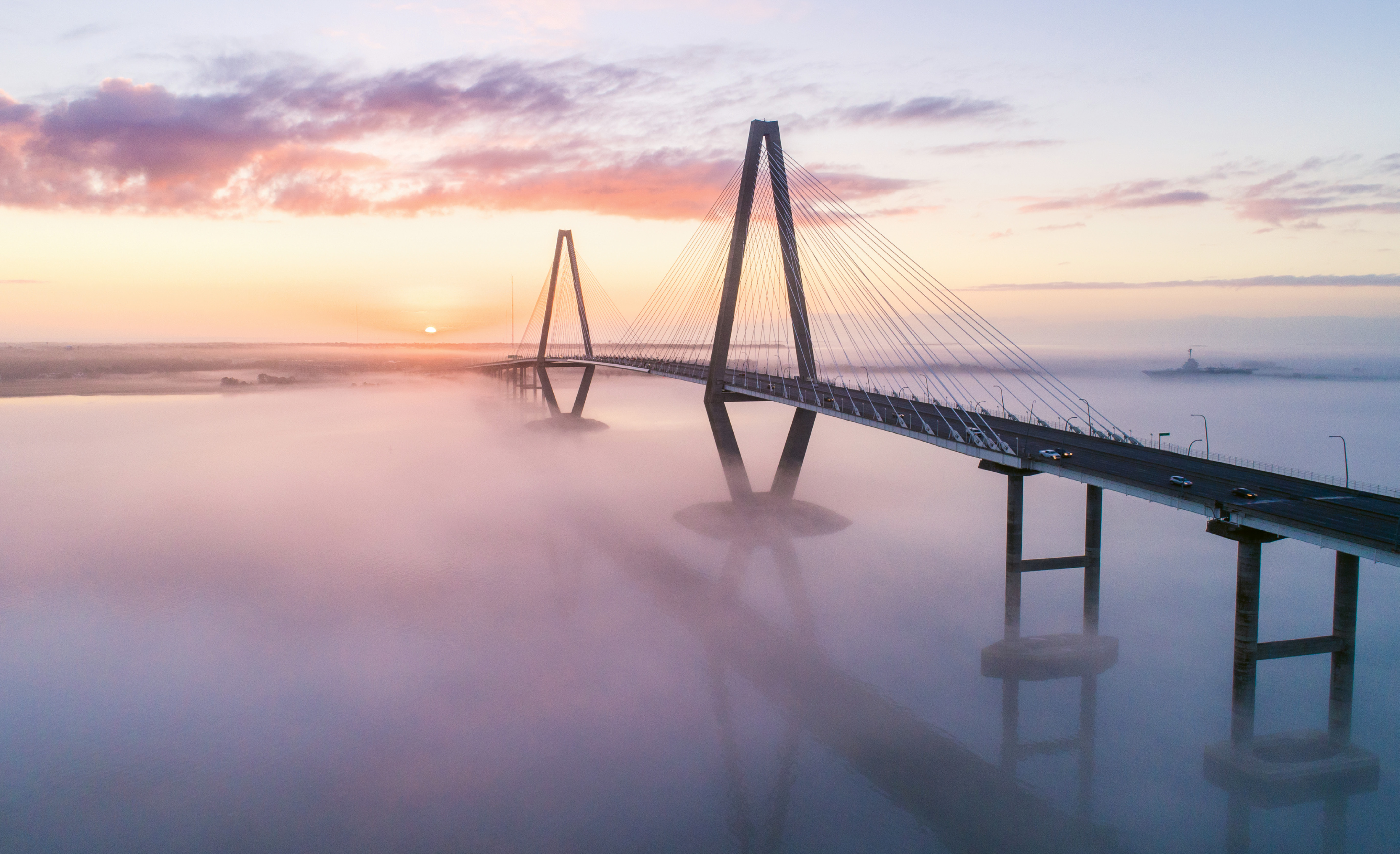 """Sea Fog at Sunrise"" {Altitude: 255 feet} In late February, a blanket of fog hovers below the Arthur Ravenel Bridge, reflecting the sunrise."