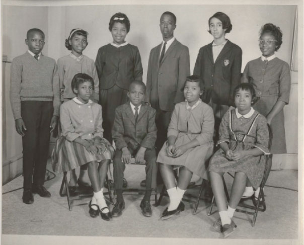 """The First Children: Though doors opened for Millicent and her 10 fellow plaintiffs—(pictured from left to right, standing) Clarence Alexander, Barbara Ford, Jacqueline Ford, Ralph Stoney Dawson, Millicent Brown, Clarice Hines, (and seated, left to right) Cassandra Alexander, Gerald Alexander, Gail Ford, Oveta Glover, and (not pictured) Valerie Wright—to attend peninsula public schools in September 1963, many faced ostracism, and worse. """"Some of the others were much younger than I was,"""" says Millicent, who still feels guilty for not being able to support her fellow Rivers High attendee, eighth grader Jackie Ford, whom she wouldn't cross paths with during the school day. """"They were more vulnerable than I was."""""""