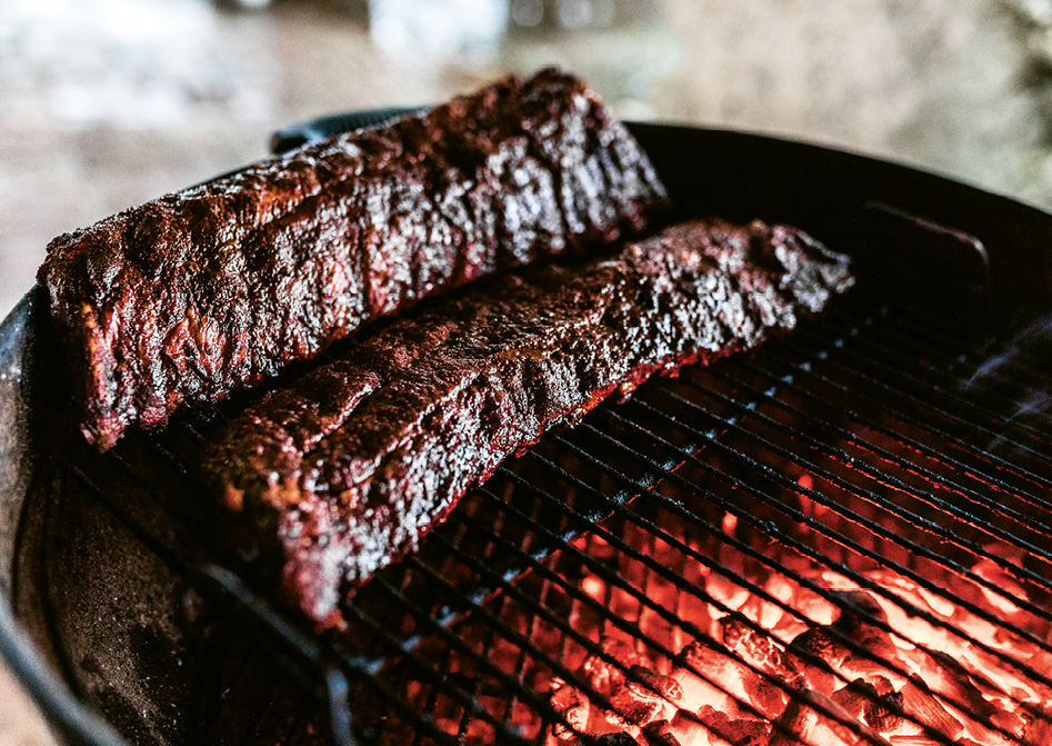 """Hagood advises slicing the ribs in one- to two-bone pieces, letting the bone guide the knife rather than cutting down the center of two bones, to provide a full """"section"""" of meat."""