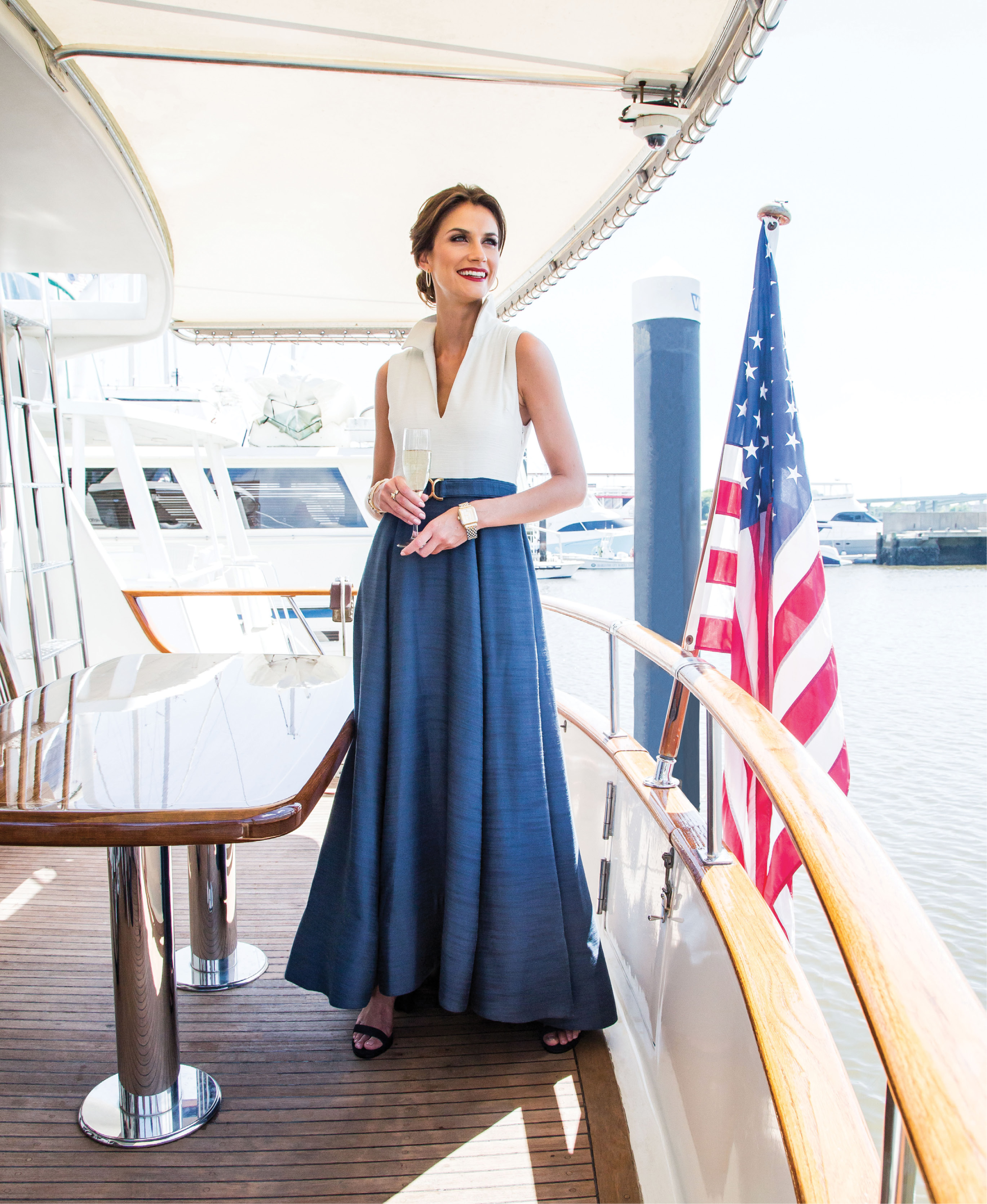 """Mason Hosker """"Charleston"""" gown, $1,270 at Mason Hosker; Stuart Weitzman """"NearlyNude"""" suede sandal in """"blue,"""" $398 at Shoes on King; 14K yellow-gold and diamond hoops, $5,000, and Michele """"Deco Madison"""" two-tone, diamond-dial watch, $1,495, both at Polly's Fine Jewelry; David Yurman 18K gold and diamond """"Chatelaine Bypass Ring,"""" $850 at REEDS Jewelers; Stern Collection 14K white-, yellow-, and rose-gold link bracelet with diamonds, $5,600 at Diamonds Direct; 18K yellow-gold and diamond station bangle $4,260 at Croghan's Jewel Box"""