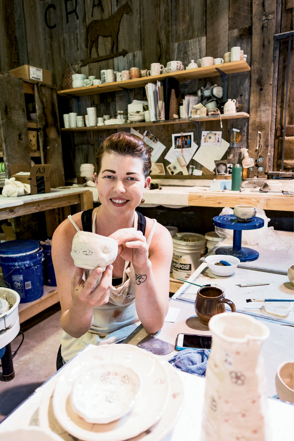 Ceramicist Samantha Oliver at work at The Bascom, a community arts center and gallery in Highlands
