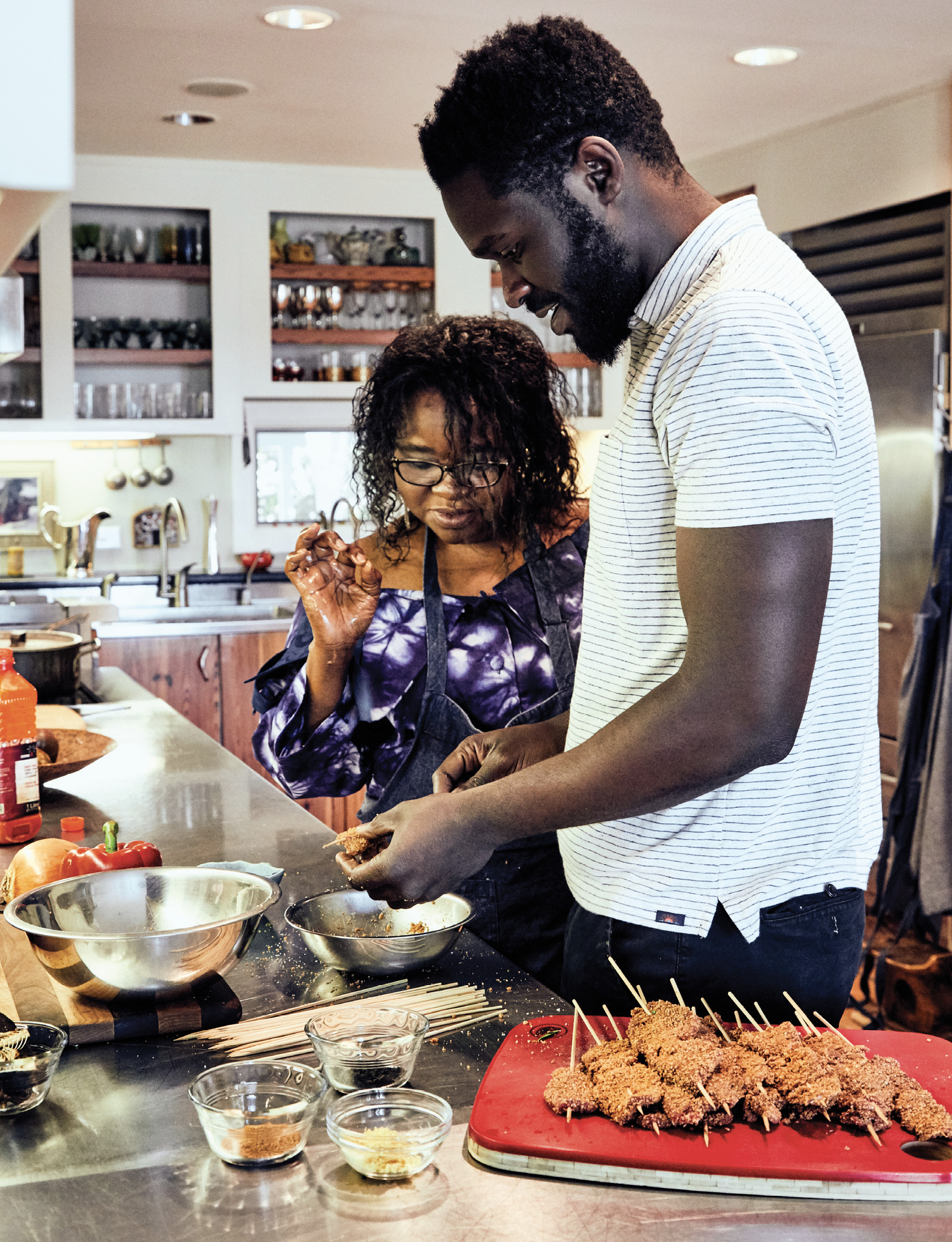 """Though he moved away from Nigeria as a baby, Femi holds an affinity for the Yoruba dishes of his youth. He often seeks his mother's cooking guidance over the phone. """"She always seems to know what I'm about to ask,"""" he says."""