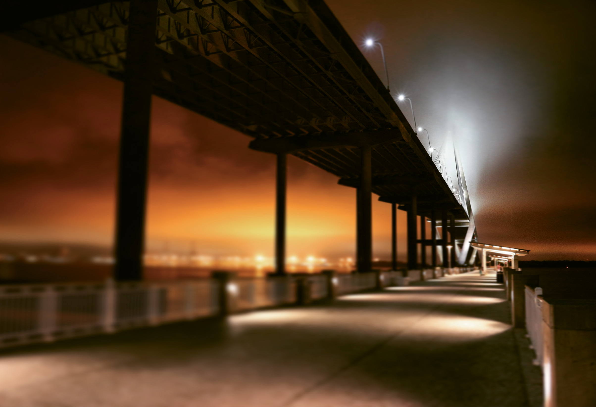 A Walk Under the Bridge by Samuel Hunter  {Amateur category} - The orange glow of light pollution as seen from Mount Pleasant's Memorial Waterfront Park
