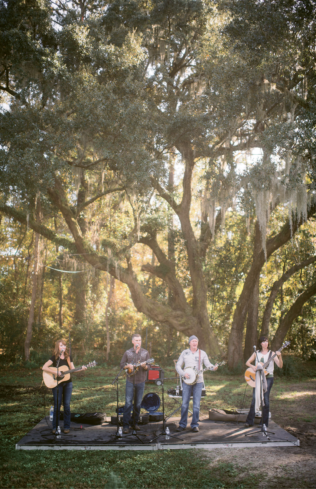 "Make Merry: Bluegrass band Common Ground played throughout the afternoon. ""The band was a splurge, for sure, but I felt it made all the difference!"" says Melissa. When hosting a more low-key event, simply pipe in country or bluegrass tunes from a docking station."