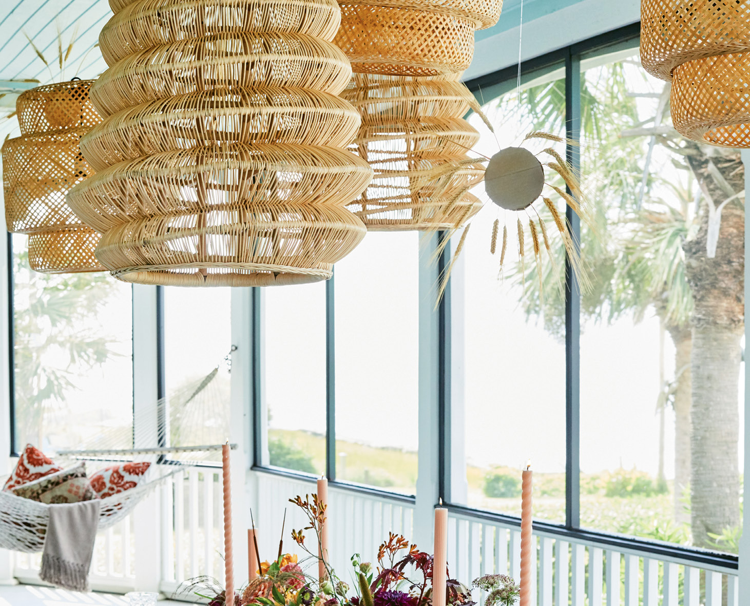 A grouping of rattan shades in different sizes and shapes delivers interest and intimacy.
