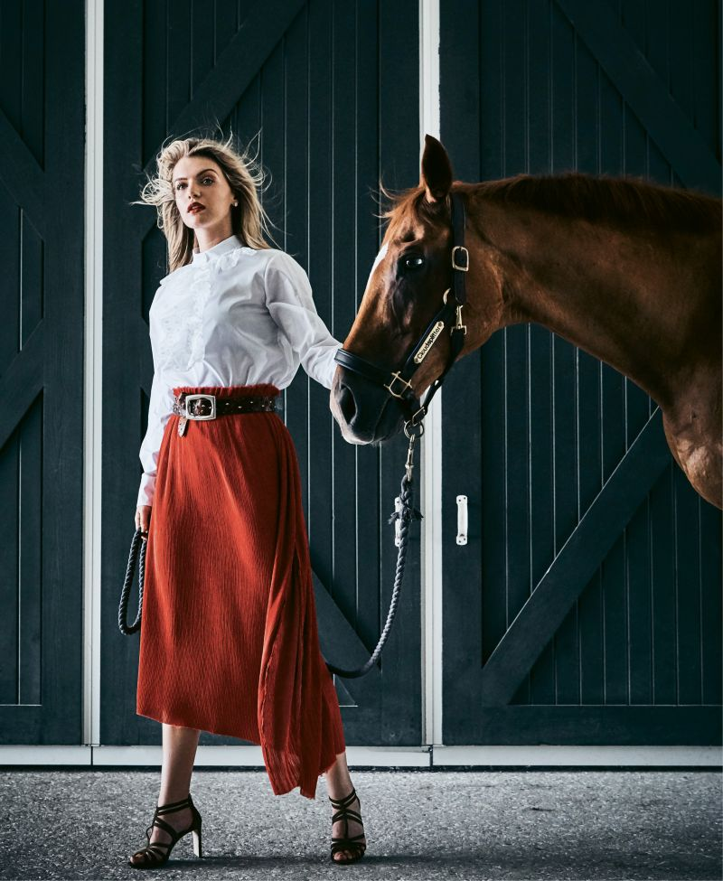 "Taking the Lead - Chloé embroidered poplin blouse, price upon request at RTW; Verandah silk-blend midi skirt, $228 at Maris DeHart; Suzi Roher leather belt, $462, and Jimmy Choo ""Selina"" suede sandal, $850, both at Gwynn's of Mount Pleasant; Spartina 449 ""Night & Day"" crystal earrings, $24 at Woodhouse Day Spa.  Pictured with Cloudsplitter (owned by Shelby de Freitas)"