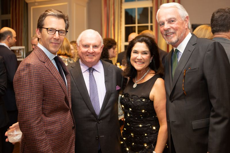Spoleto Board Chair William Medich, James and auction chair Leslie Richardson, and Jim MacLeod