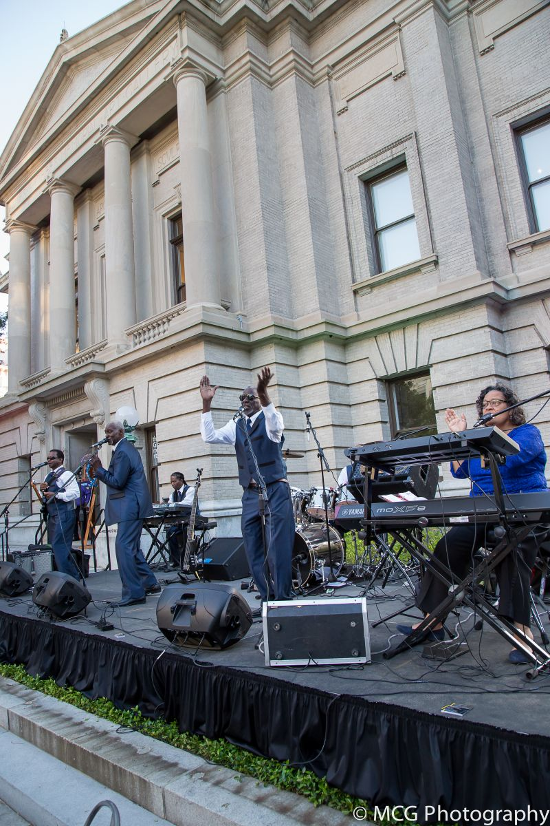 The groovy First Class Band plays against the backdrop of the museum.