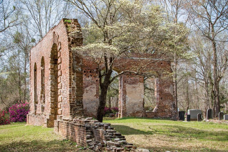 "The property near Moncks Corner was listed in the National Register of Historic Places in 1977: ""Notable architectural details which remain include a Gibbs surround at the main portal, quoins at the corner, radiating voussoirs over the windows, and a rounded water table."""