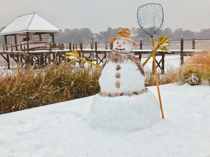 <strong>In the Marsh WeCan Build a Snowman:</strong> In West Ashley, the Lipov family built the quintessential Lowcountry snow-fisherman, complete with palmetto frond hands and oyster shell buttons; <em>photograph byLarry Lipov</em>