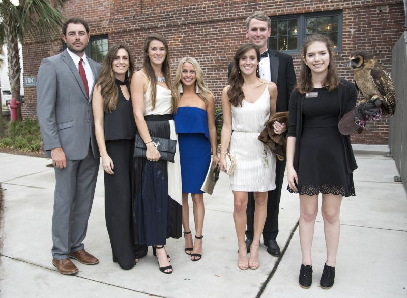 James Morris, Tara Merino, Carson Lunceford, Taylor Fulcher, Cole Armstrong, Mary McGill Armstrong, and Hayley Eynon with an Asian brown wood owl