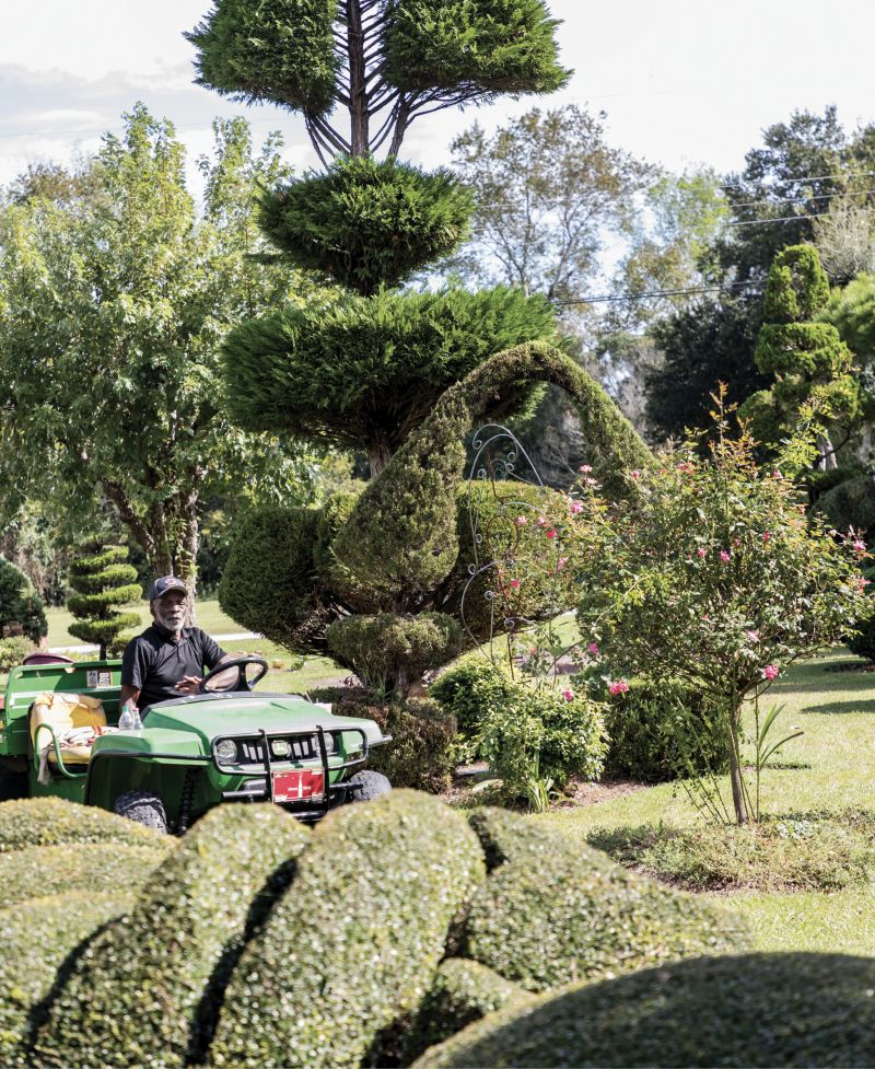 """CRUISE CONTROL: Fryar, age 79, makes daily rounds in his utility vehicle and was once featured in a John Deere commercial. He says, """"Success takes hard work, passion, and marketing."""""""