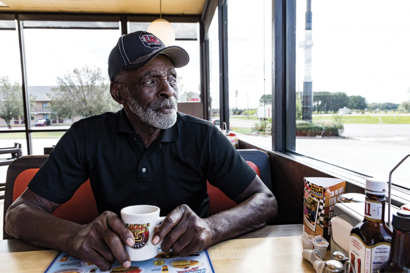 """Stopping into the Waffle House in Bishopville for coffee or a meal—maybe the """"Pearl Special""""—is a daily ritual for Fryar. It also gives him a chance to check on the shrubs out front that he maintains in his topiary style."""