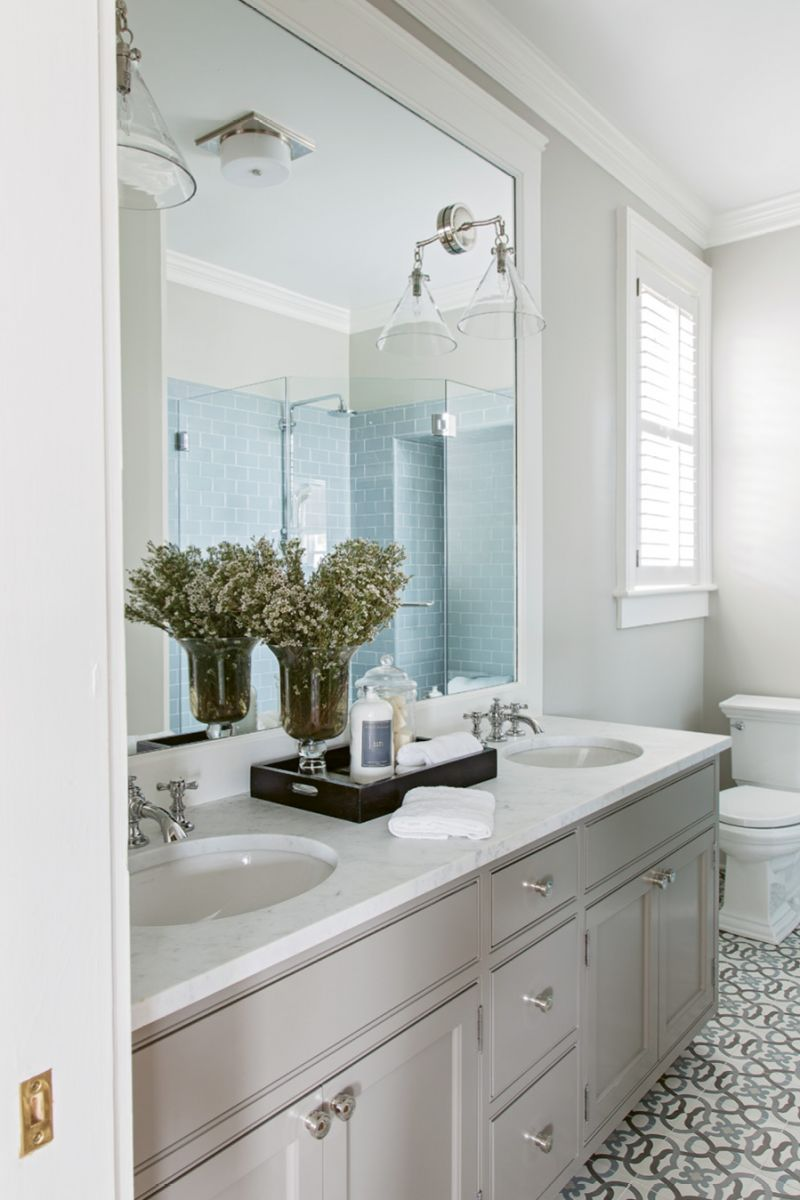"Floored: ""I loved the simplicity of the pattern,"" says Peake of the cement tiles that set the tone for the master bath. Tiling the bathrooms was the only instance where the original floors were altered."