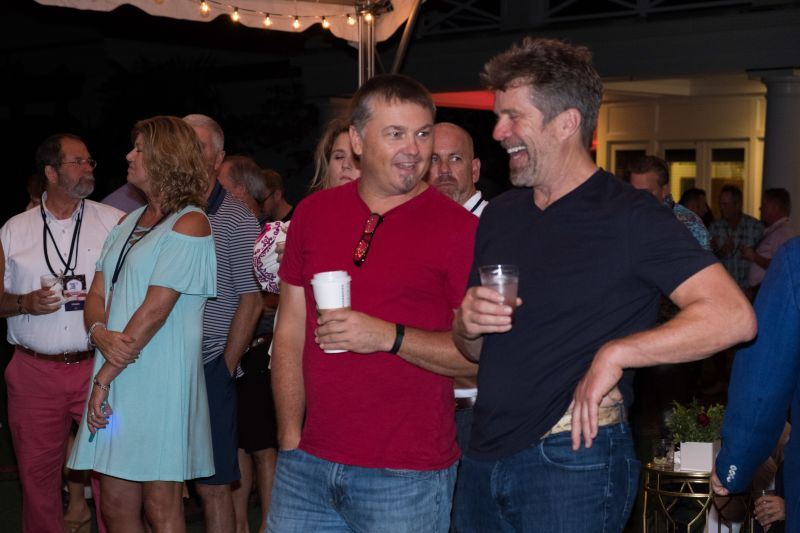 Musician Edwin McCain chats with a friend before the concert.