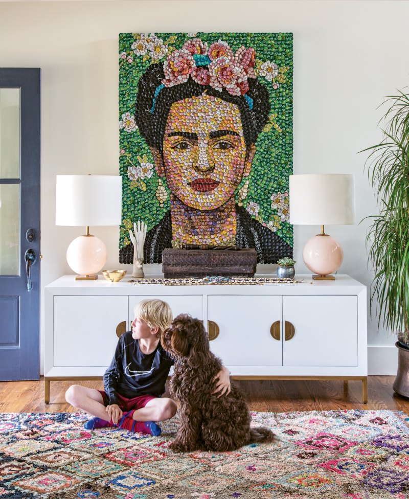 """Captivating Entry: Colorful and joy-filled artwork, like this bottle-cap portrait of Frida Kahlo by area artist Molly B. Right, jives well with the Williamsons' lively home, as does the open floor plan. """"The boys are so dynamic; the level of activity here is insane,"""" says Allison."""
