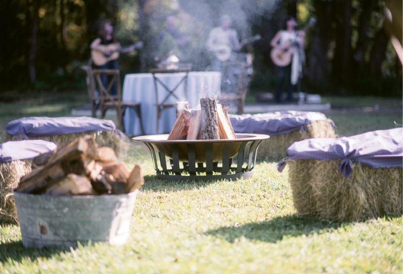 """Down-Home Details: A """"country cool"""" dress code ensured guests arrived ready to traipse about the rural venue. Hay bales picked up from a nearby supply store and barrels rented from Snyder Events added rustic charm aplenty."""