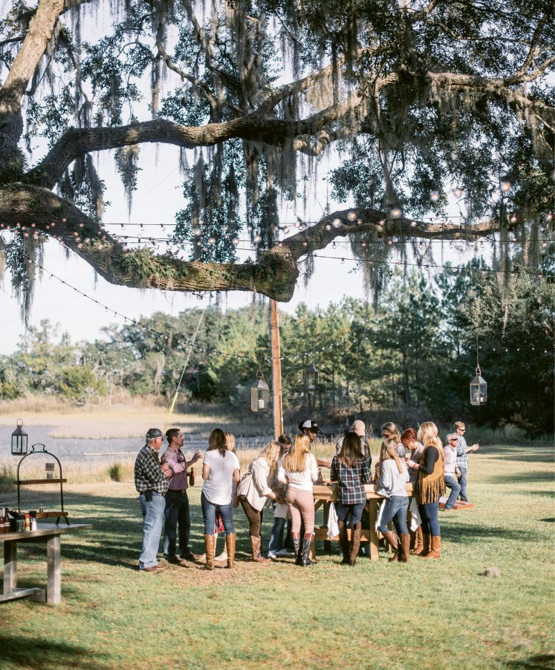 Work the Space: The oyster table was placed in the shade of a grand live oak. With Spanish moss and resurrection ferns clinging to the branches above, the decor could be rustic and minimal.