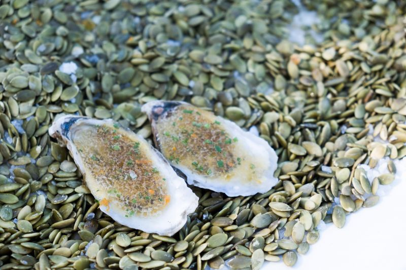 """""""Lowcountry Cups"""" from Lowcountry Oyster Co. featured pineapple dashi, finished with red lime."""