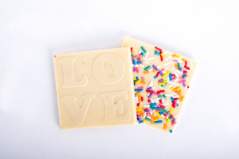 "White chocolate ""Love"" square with sprinkles, $4 at Christophe Artisan Chocolatier"