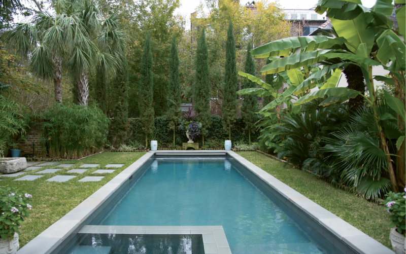 Calm & Cool: The garden's final room conjures the Mediterranean with an all-green landscape that mingles Italian cypress trees, Confederate jasmine, variegated flax lily, sago palms, and banana trees.